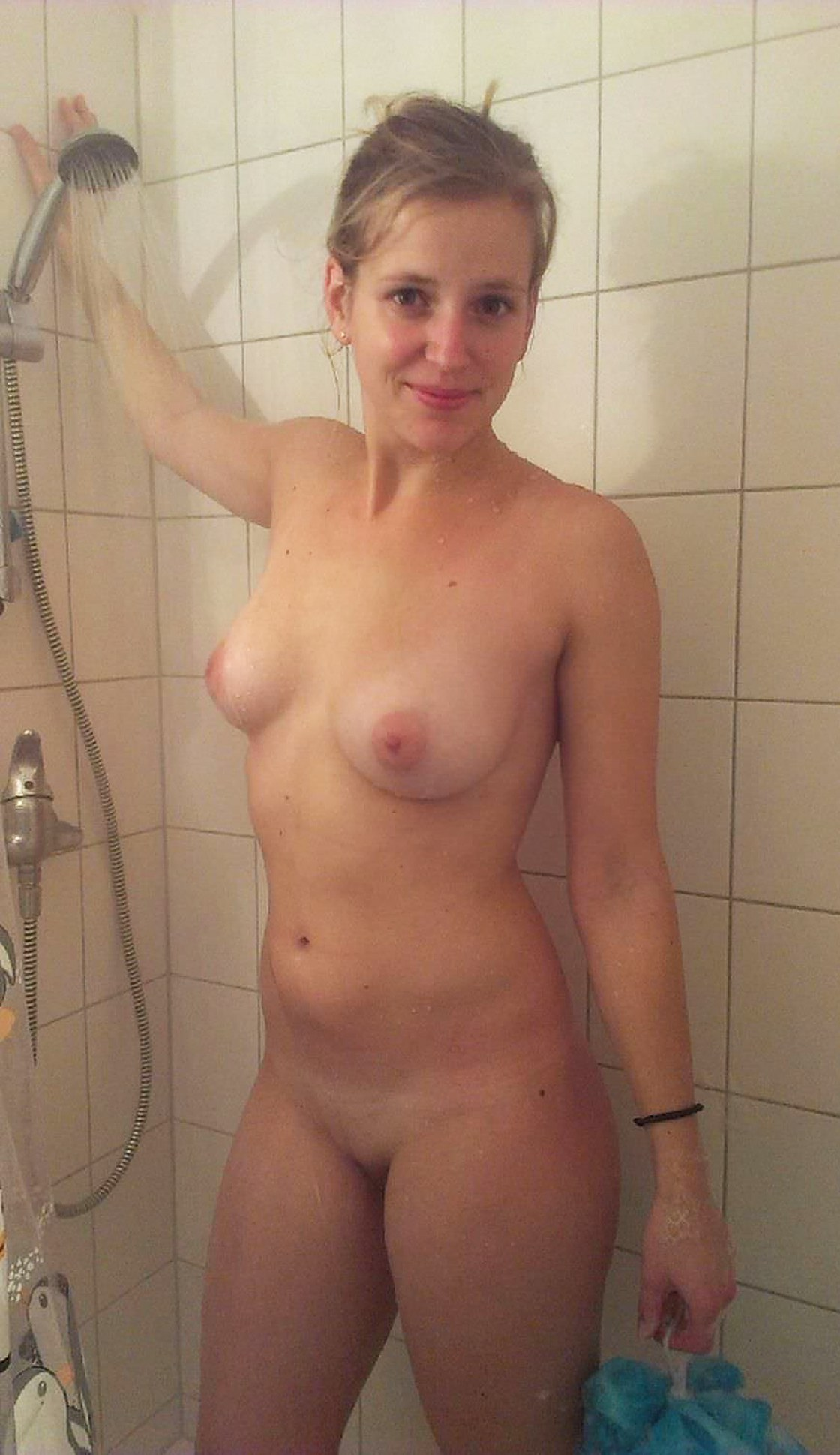 Amateur woman with sexy body in shower