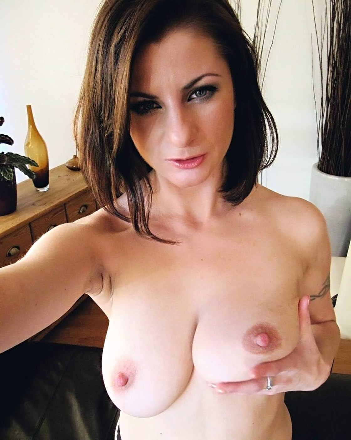 Beautiful busty brunette doing nude selfie