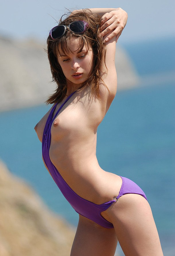 Julietta – Brunette takes off her purple bikini near the sea