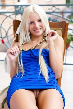 Blond in a blue dress shows nice pussy