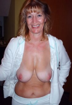 Busty Mature Shows Tits