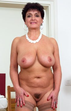 Hot busty mature with hairy pussy