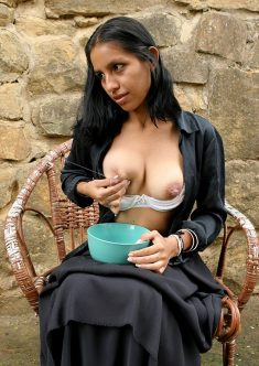 Indian girl spray the milk