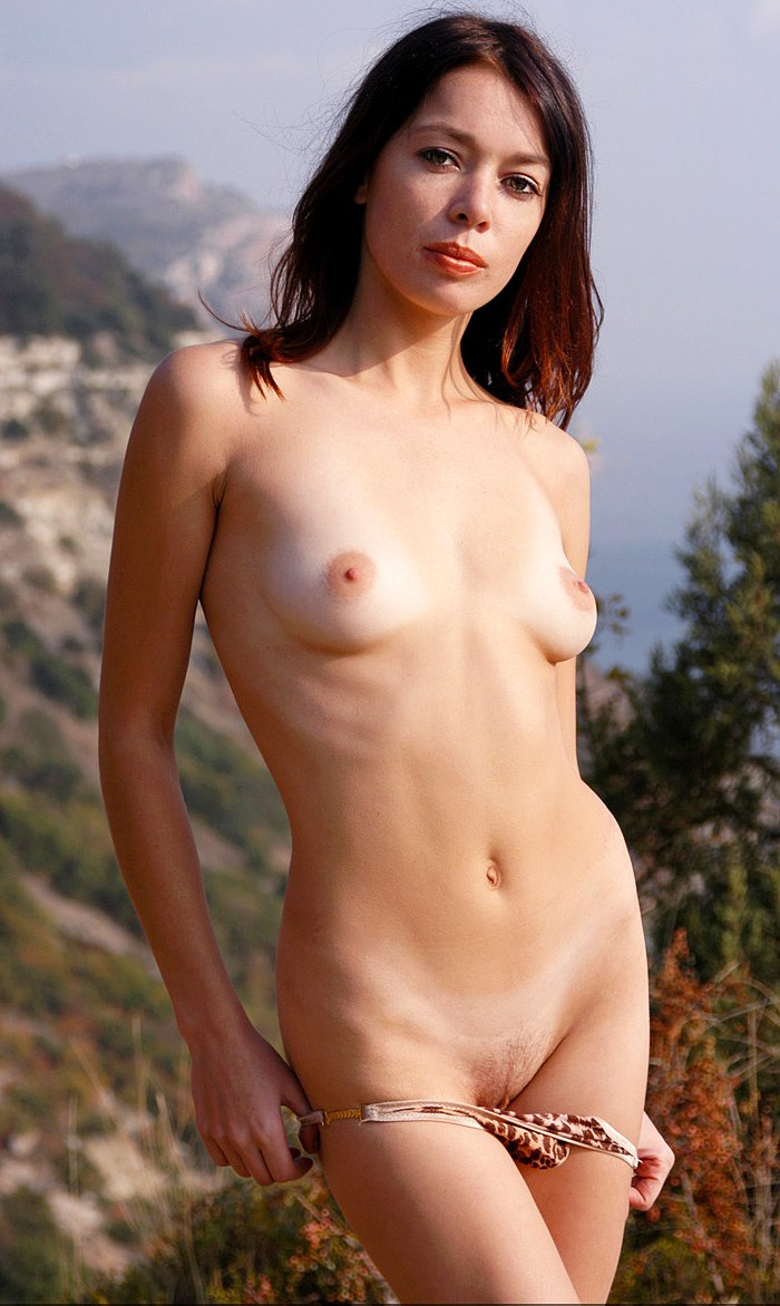 Naked red-haired girl with beautiful body