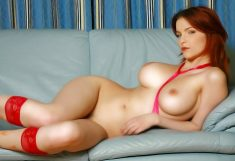 Redheaded girl with big tits