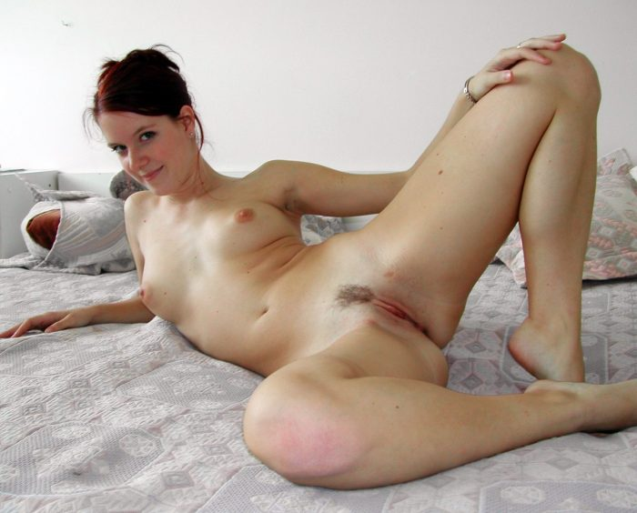 Amateur redhead on bed