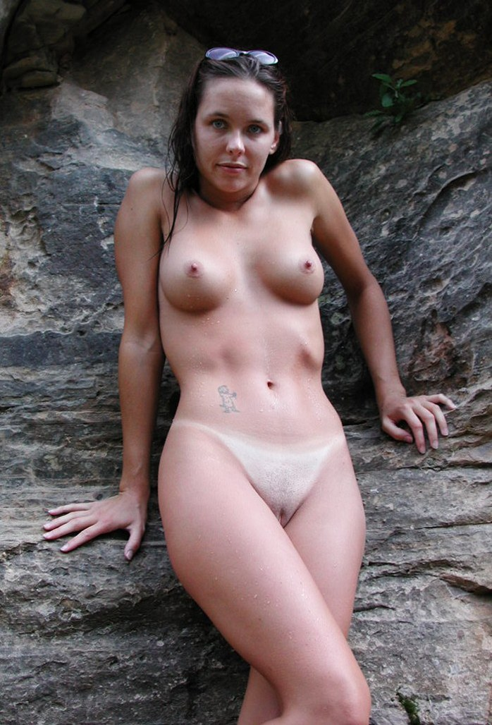 Beautiful sexy brunette at a rock