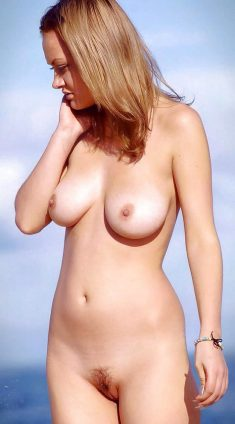 Busty girl loves showing her naked body to the world