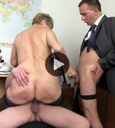 German woman with big breasts fucks in office