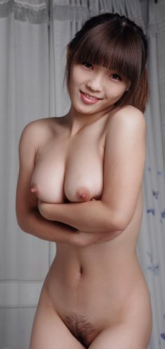 Beautiful young Asian girl shows her nice tits and hairy pussy