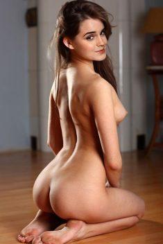 Naked Emma Watson sitting on the floor