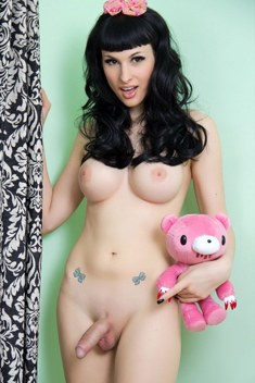 Adorable t-girl Bailey Jay poses with her pink teddy