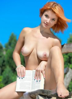 Beautiful session of busty redhead, who loves to read Harry Potter naked