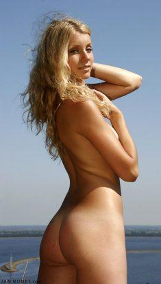 Beautiful Ukrainian blonde Maquiera is naked outside