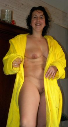 Mature woman with a shaved pussy in a yellow bathrobe