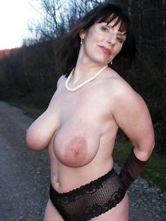 Mature woman with huge breasts