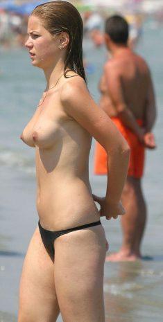 Young sexy girl topless on beach