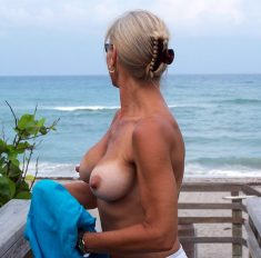 Amateur Milf with perfect breasts by the sea