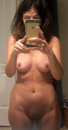 Cute naked woman doing naked selfie
