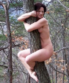 Naked woman on the tree