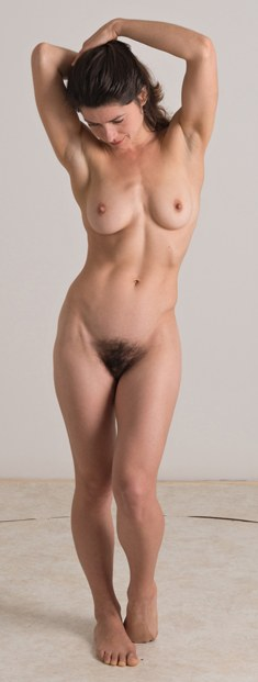 A muscular woman with a hairy pussy