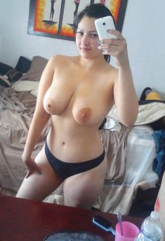 Amateur girl in black panties shows large breasts