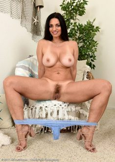 Busty brunette with hairy pussy