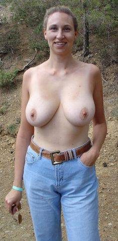 Busty MILF topless outdoors