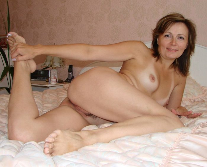 Seductive milf on bed