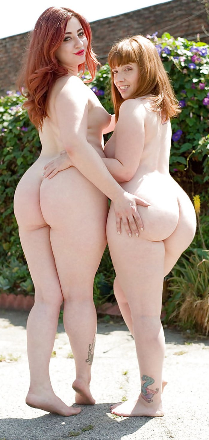 Two overweight women show big butts outdoors