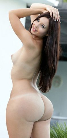 A long-haired brunette with a large round ass