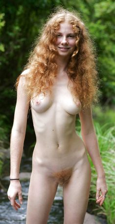 Slim curly girl with a hairy pussy