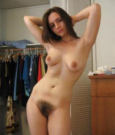 Nude girl with hairy pussy