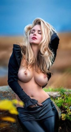 Seductive blond girl with nice big breasts