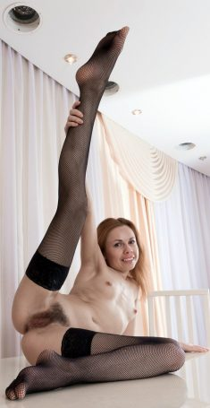 Slim girl Liliya shows hairy pussy in black stockings