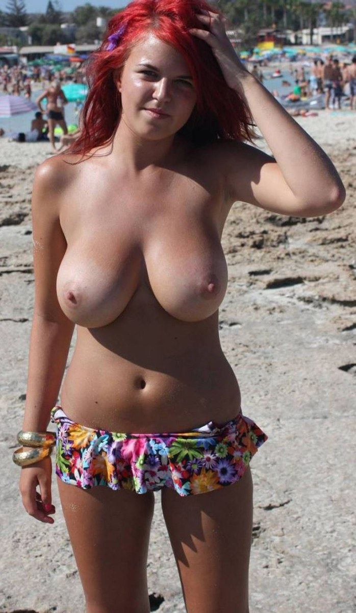 Young busty girl on beach
