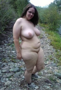 Fat girl naked outdoors only in sneakers