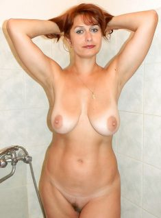 Busty redhead in the bathroom