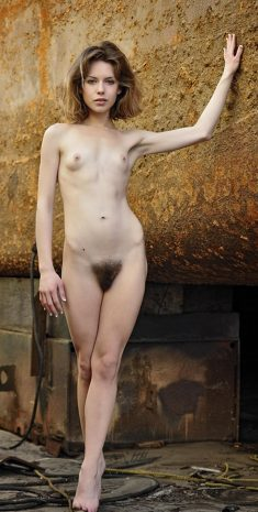 Young athletic naked girl with small breasts