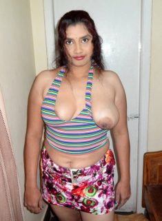 An Indian girl shows one breast