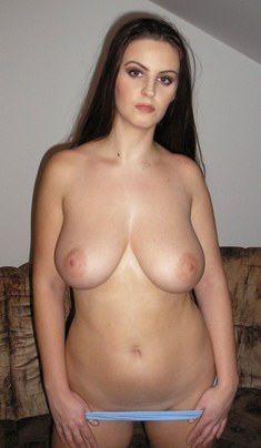 Busty amateur Janella naked in front of the couch