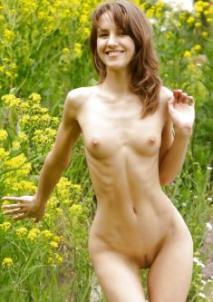 Slim smiling girl naked in nature