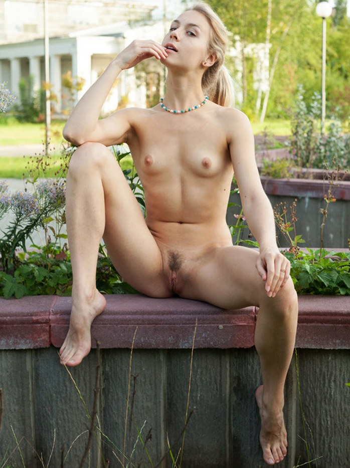 Steaming hot chick shows her juicy pussy in different poses in a park
