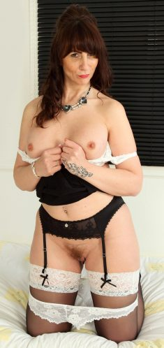 Frisky UK mom Toni Lace with hairy pussy in sexy lingerie