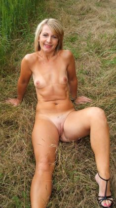 Hot naked Milf in the grass