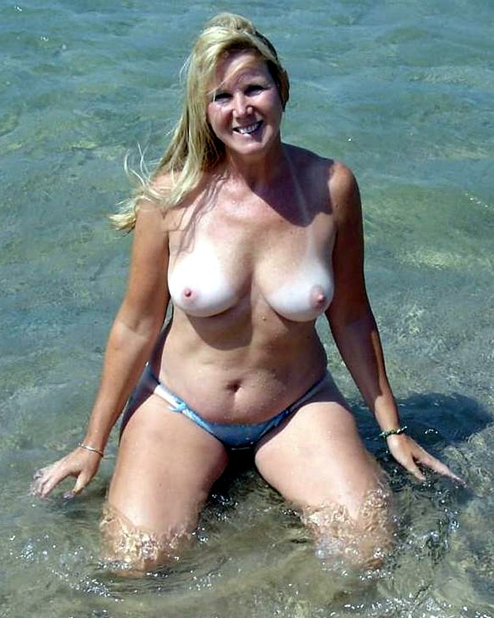 Amateur Milf showing breasts with tan lines