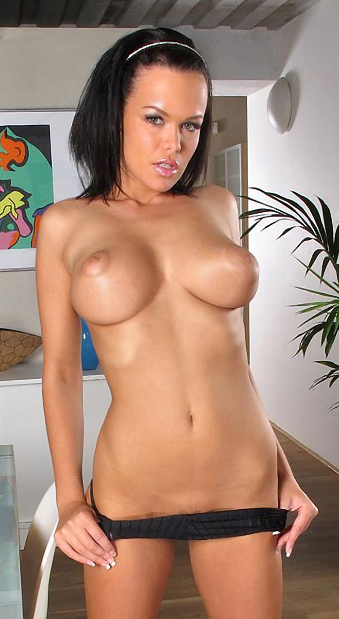 Busty brunette stripping