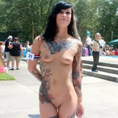Tattooed brunette naked on public