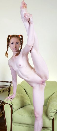 Slim redhead with small tits Twinkle has stunning green eyes