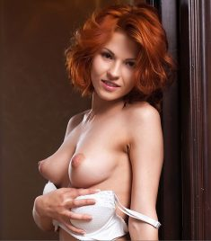 Smiling redhead shows perfect breast and nice pussy